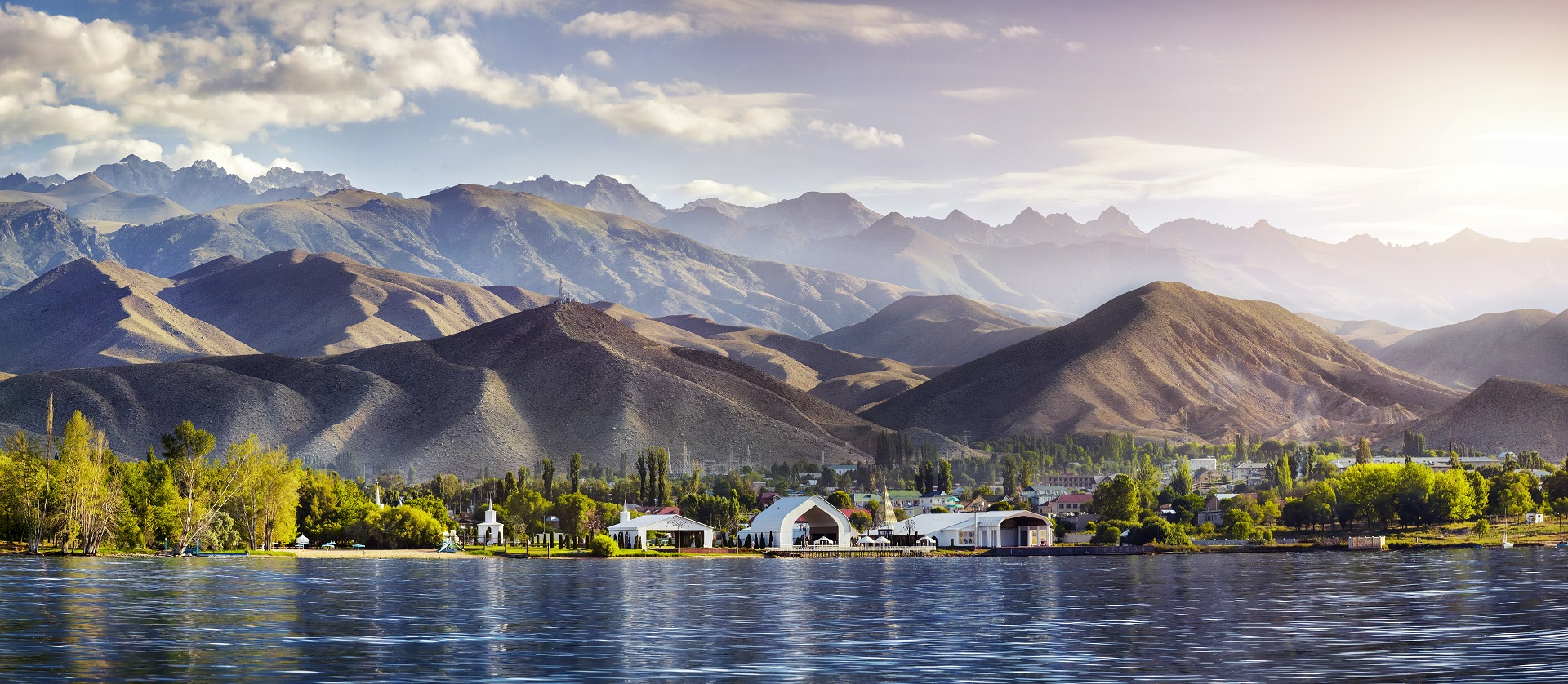 View to Ruh Ordo cultural complex near Issyk Kul lake at mountains background in Cholpon Ata, Kyrgyzstan